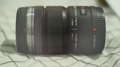 奥林巴斯12-50mm电动变焦镜头 95新