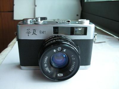 很新华夏841金属制造旁轴相机,有测光,收藏使用,送皮套