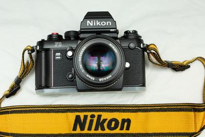 99成新尼康F3HP收藏级胶片机外加原装手柄50镜打包收售
