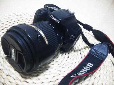 佳能550D(1300元)和腾龙17-50mm F/2.8(1400元),共2700元。