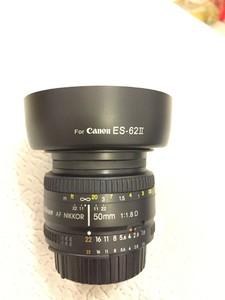 9.99成新尼康 50/1.8D 定焦镜头,镜头完美,配肯高uv镜和遮光罩