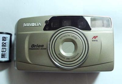 没装过胶卷的美能达AF38-105mm变焦自动傻瓜相机带自拍和防红眼功